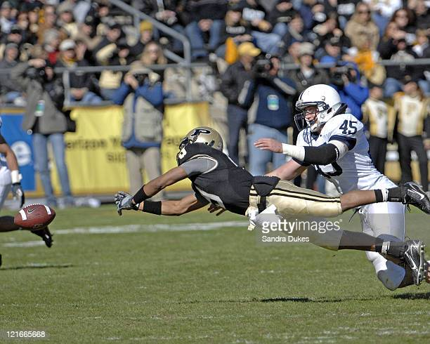 Purdue's Dorien Bryant dives for a pass out of his reach as Sean Lee defends in Penn State's 12-0 win over Purdue at Ross-Ade Stadium in West...