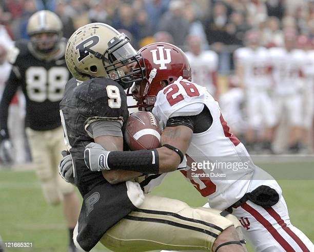 Purdue's Dorien Bryant is tackled by Indiana's CB Leslie Majors as he catches the ball. Bryant held on. Purdue defeated Indiana 28-19 in Ross Ade...