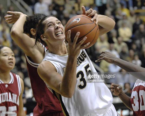 Purdue's Erin Lawless goes for a shot as she is surrounded by Indiana defenders in the game won by Purdue 7351 over Indiana in Mackey Arena West...