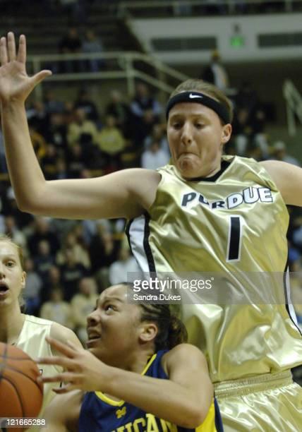 Purdue's Katie Gearlds blocks the way of Jessica Minnfield's drive in the first half of Purdue's 75-50 win in Big Ten play in Mackey Arena, West...