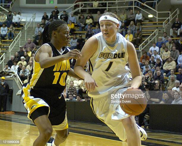 Purdue's Katie Gearlds drives past Crystal Smith in Purdue's 7975 win at Mackey Arena W Lafayette Indiana on January 23 2005