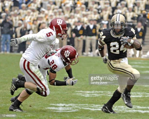 Purdue's Kory Sheets tries to outrun Indiana's Leslie Majors and Troy Grosfield. Purdue defeated Indiana 28-19 in Ross Ade Stadium, West Lafayette,...