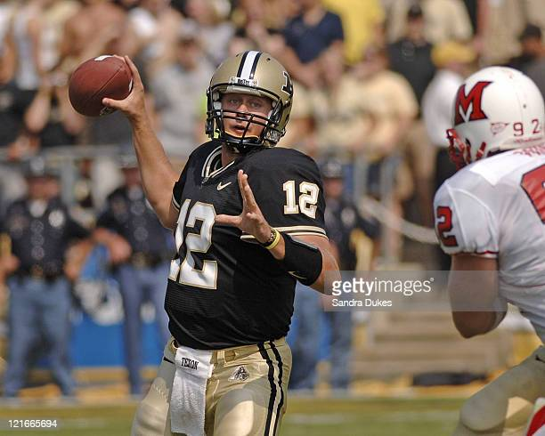 Purdue's QB Curtis Painter looks to pass under pressure in Purdue's OT 38-31 win over Miami of Ohio at Ross Ade Stadium in West Lafayette, IN....