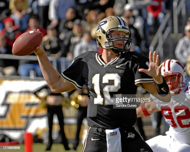 Purdue's QB Curtis Painter passes as Wisconsin's RE Matt Shaughnessy closes in in Wisconsin's 243 win over Purdue in Ross Ade Stadium West Lafayette...