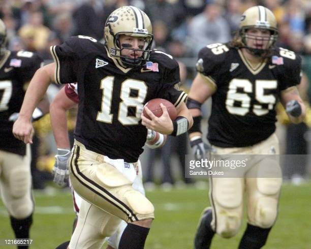 Purdue's quarterback Kyle Orton runs out of the pocket in Purdue's 6224 win over Indiana at Ross Ade Stadium West Lafayette Indiana on November 20...