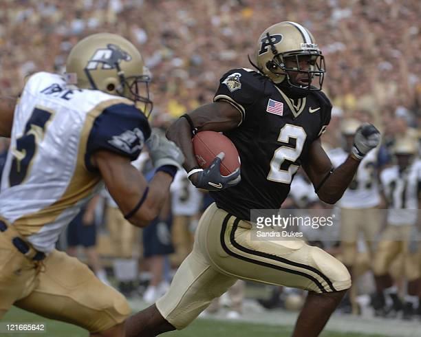 Purdue's Ray Williams is chased by Davanzo Tate as he goes for a TD in the first quarter of Purdue's 49-24 win over Akron at Ross Ade Stadium in West...