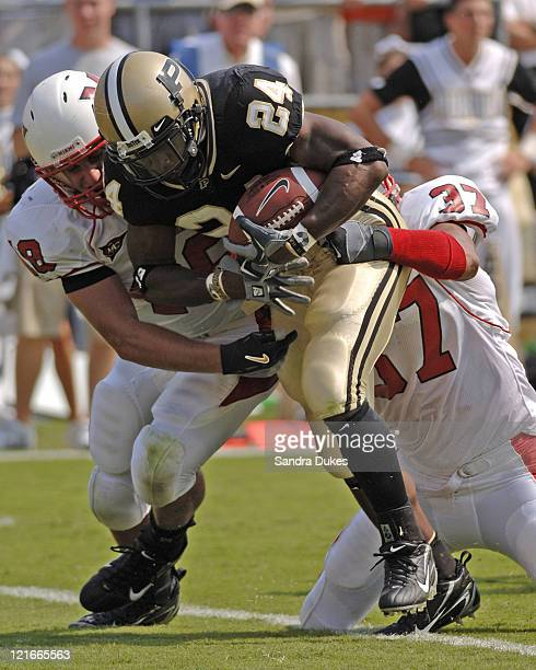 Purdue's RB Kory Sheets drags 2 tacklers with him as he runs up field in Purdue's OT 38-31 win over Miami of Ohio at Ross Ade Stadium in West...
