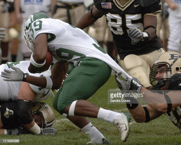 Purdue's Rob Ninkovich tries to stop MSU's Javon Ringer in Purdue's 2821 win over Michigan State in Ross Ade Stadium West Lafayette IN