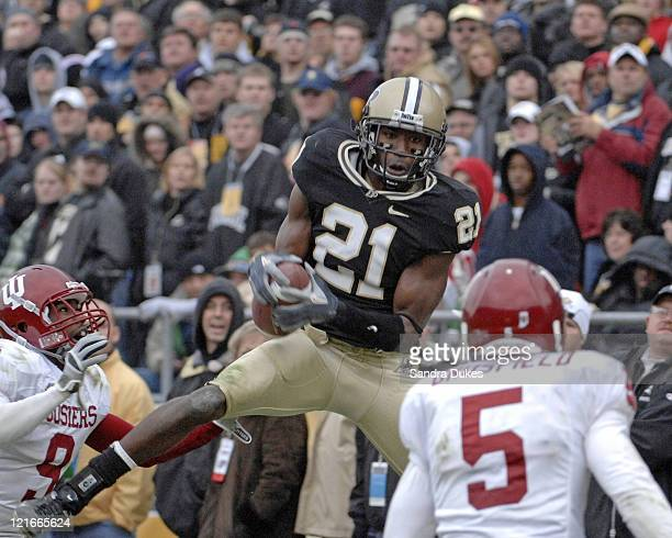 Purdue's WR Greg Orton makes a catch over Tracy Porter 9 and Troy Grosfield in the second half. Purdue defeated Indiana 28-19 in Ross Ade Stadium,...