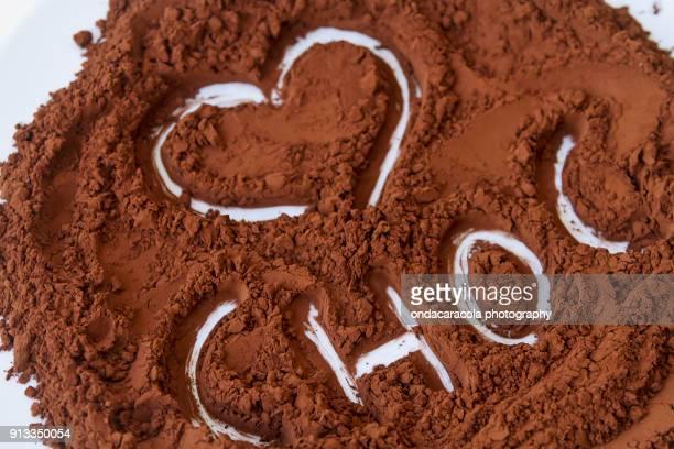 pure cocoa powder - theobroma stock-fotos und bilder
