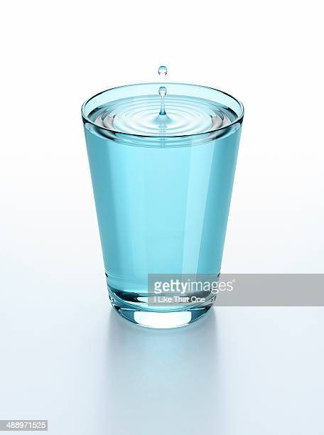 Pure water droplet in glass of water