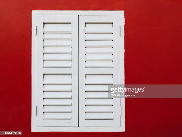 A pure white window on red wall