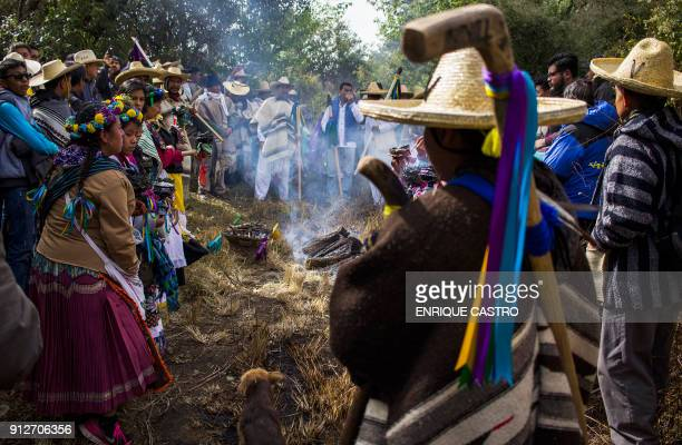 Purepecha indigenous people take part in a ritual during the beginning of the celebration of the Purepecha New Year in Chilchota Michoacan state...