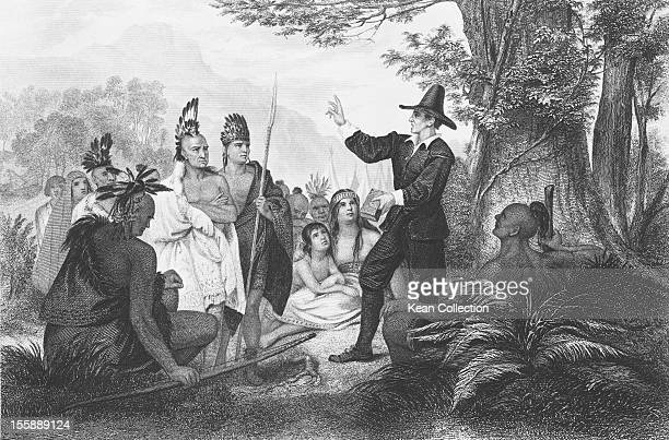 Puritan missionary John Eliot preaches to a group of indigenous American tribespeople in Massachusetts circa 1665 Engraved by J C Butte after a...