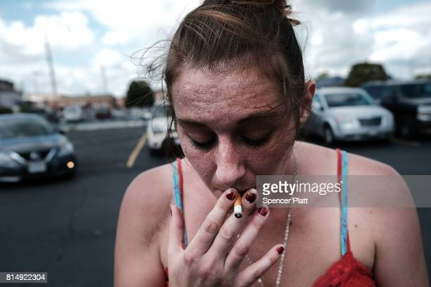 Purity a heroin addict who is looking for help to quit attends a march through the streets of Norwalk against the epidemic of heroin in the community...