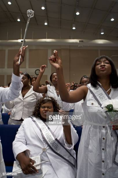 Purity Ring Ambassador Je'Quita Zachary raises her ring as she and other participants prepare to take the oath of abstinence at the Destiny World...