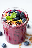 purple acai blueberry smoothie glass topped