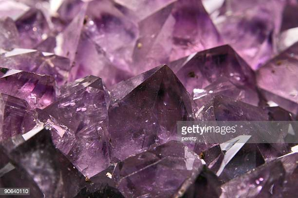 a purple amethyst crystal close-up - amethyst stock pictures, royalty-free photos & images