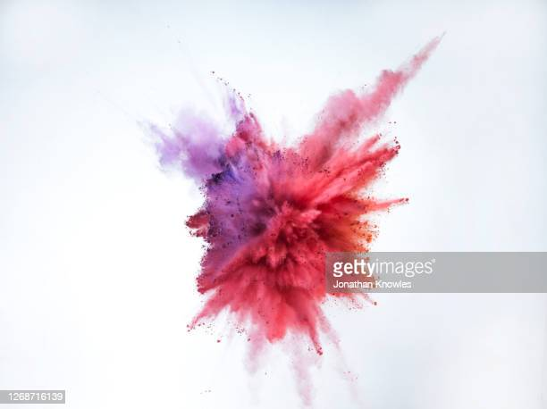purple and red powder explosion - exploding stock pictures, royalty-free photos & images