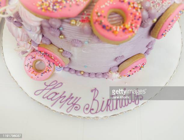 purple and rose birthday cake with donut decoration - 1周年 ストックフォトと画像