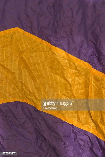 purple and yellow fabric - stiches stock photos and pictures
