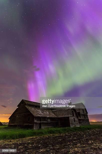 Purple aurora over an old barn in southern Alberta, Canada.