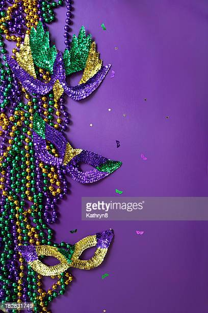 purple background - mardi gras beads stock photos and pictures