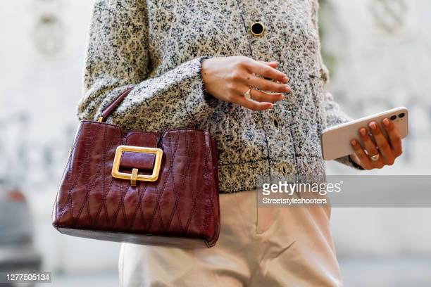 Purple bag by Bally as a detail of influencer Sarah Lou Falk, seen during the Milan Women's Fashion Week on September 28, 2020 in Milan, Italy.