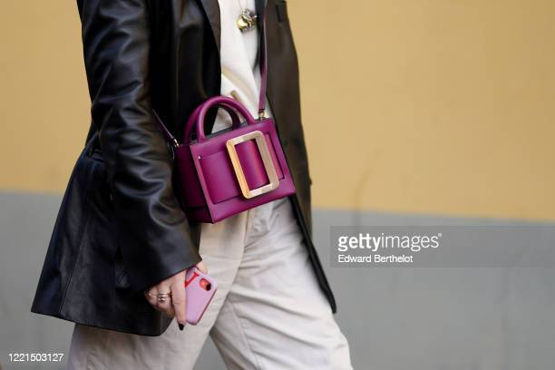 Purple bag is seen, outside Tod's, during Milan Fashion Week Fall/Winter 2020-2021 on February 21, 2020 in Milan, Italy.