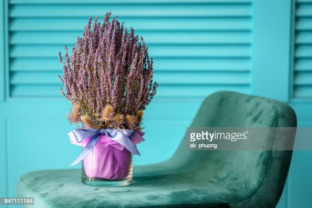 Purple bouquet on a chair with beautiful background