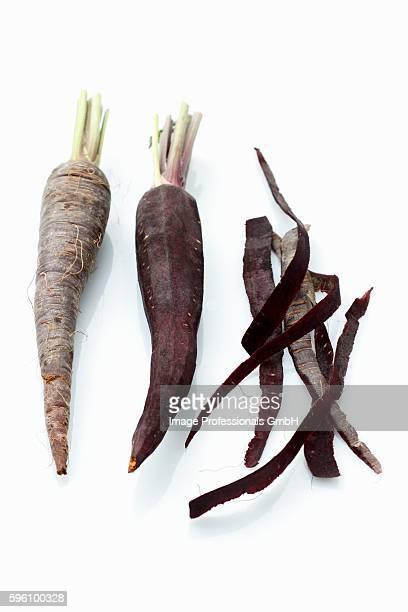 Purple carrots, peeled and unpeeled