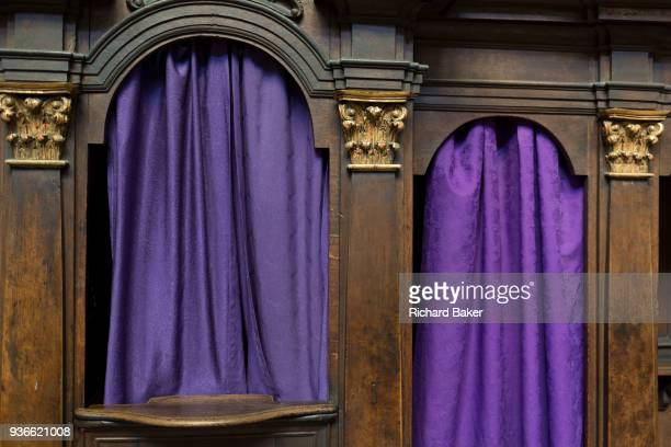 Purple Catholic confessional curtains in St Vitas' Cathedral in Prague Castle on 18th March in Prague the Czech Republic The Metropolitan Cathedral...
