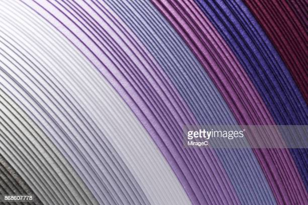 Purple Colored Paper Stacking in Curve Shape