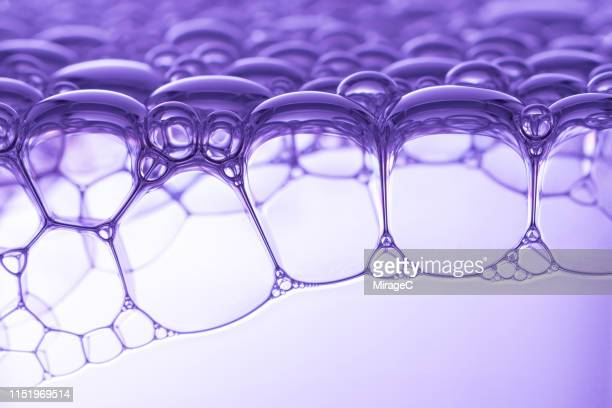 purple colored soap foam macro photography - miragec stock pictures, royalty-free photos & images