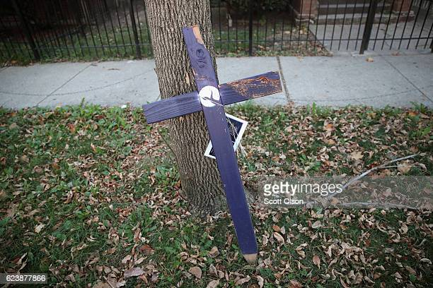 A purple cross sits along the sidewalk in the Austin neighborhood near the spot where a 29yearold man was shot and killed yesterday on November 17...