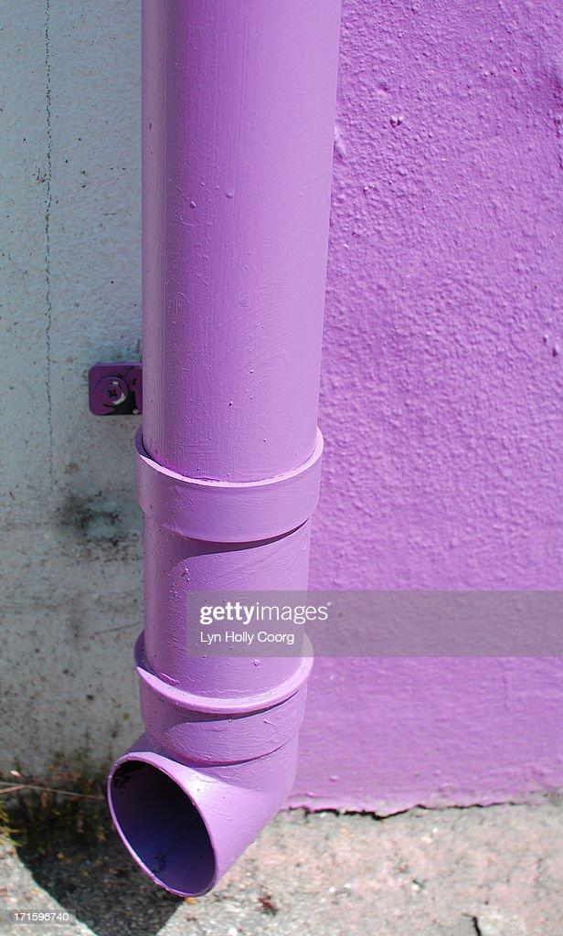 Purple drainpipe : Stock Photo