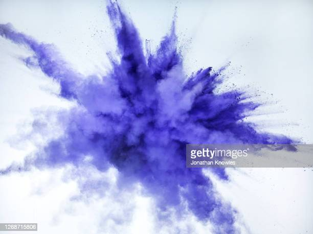 purple exploding powder - white background stock pictures, royalty-free photos & images