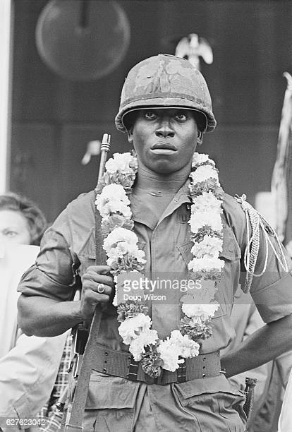 Purple Heart winner Sergeant Harold Blye of the United States Army's 3rd Battalion 60th Infantry 9th Division stands at attention wearing a lei as...