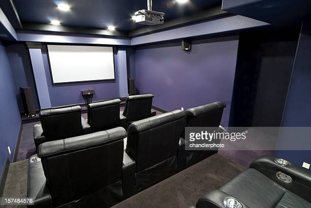 purple home theater room - entertainment center stock pictures, royalty-free photos & images