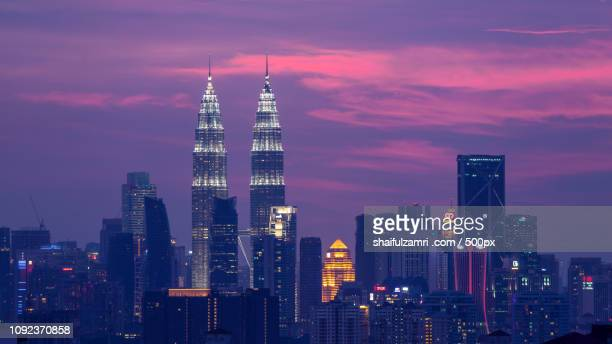 purple hour - shaifulzamri stock pictures, royalty-free photos & images