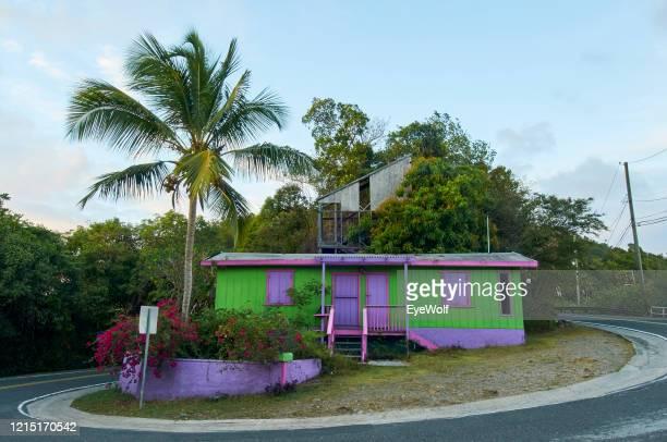 a purple house build on the curve of a road in st. thomas, usvi - paisajes de st thomas fotografías e imágenes de stock