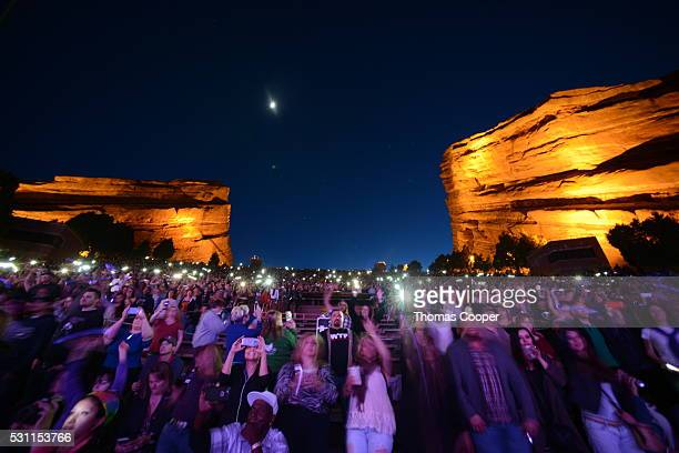 A purple hue over fans during an allstar tribute concert for Prince at Red Rocks Amphitheatre on May 12 2016 in Morrison Colorado The Denver Film...