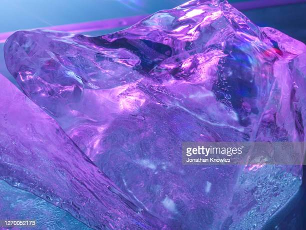 purple ice block - ice stock pictures, royalty-free photos & images