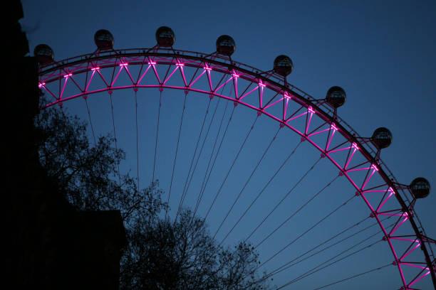 GBR: London Eye Tourist Attraction At Dawn