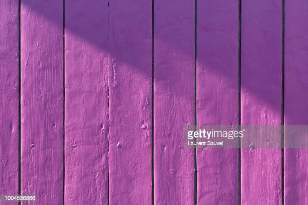purple painted wood background - purple background stock photos and pictures