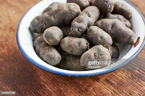 Purple potatoes in an enamel bowl