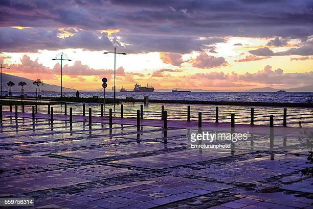 purple skies above izmir bay - emreturanphoto stock pictures, royalty-free photos & images