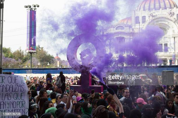 Purple smoke rises as demonstrators gather during a rally on International Women's Day in Mexico City Mexico on Friday March 8 2020 The United...