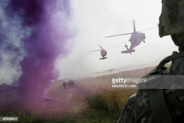 Purple smoke rises from a grenade as two Black Hawk helicopters arrive for waiting US soldiers of 1st Battalion 187th Infantry Regiment 101st...