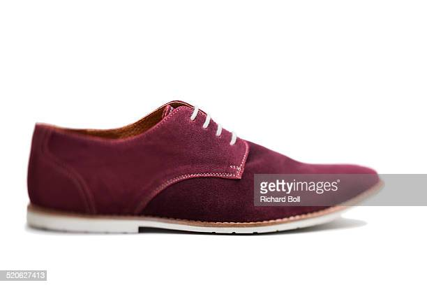 A purple suede shoe on a white background